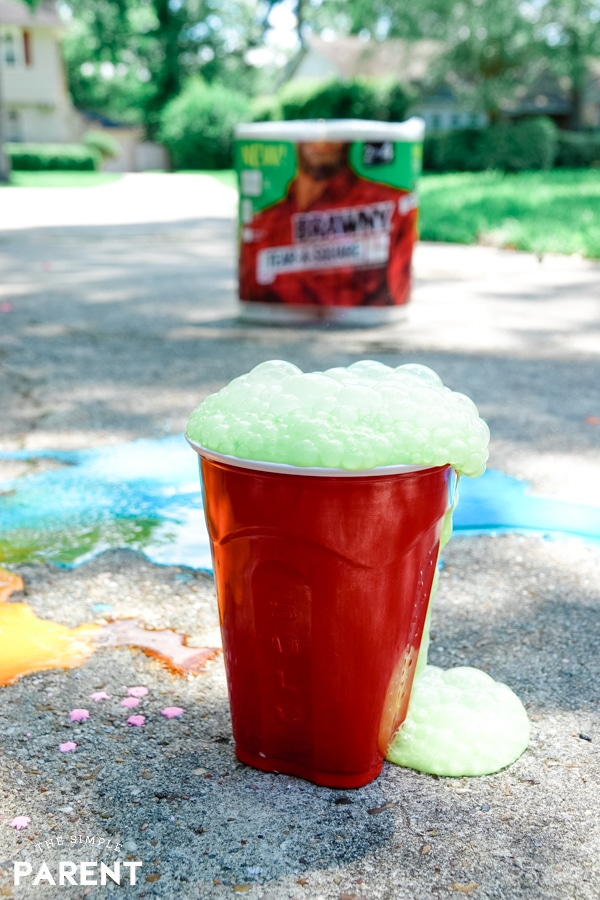 Bubbling sidewalk chalk volcano in a cup