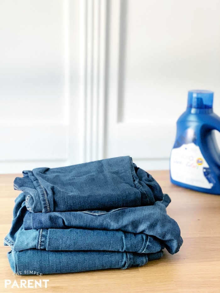 Stack of jeans and laundry detergent