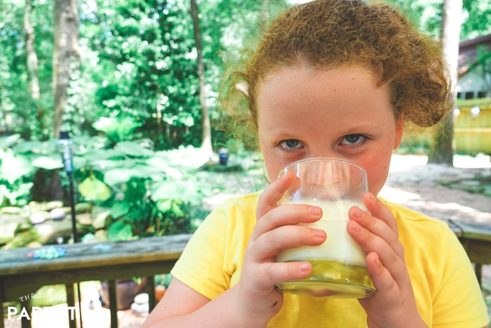Girl drinking a glass of milk
