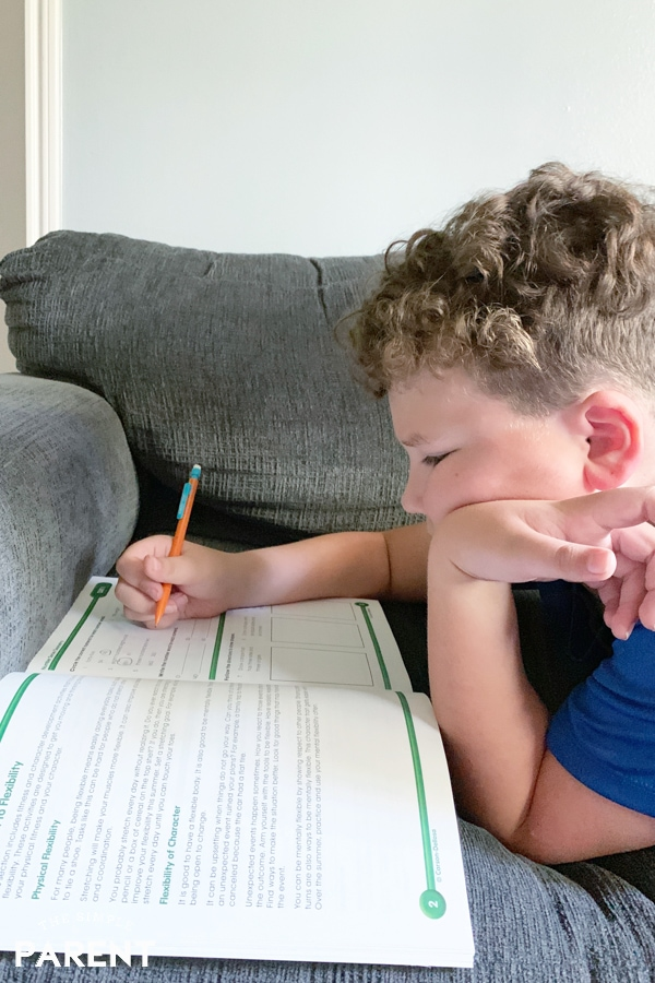Boy working in summer Learning workbook