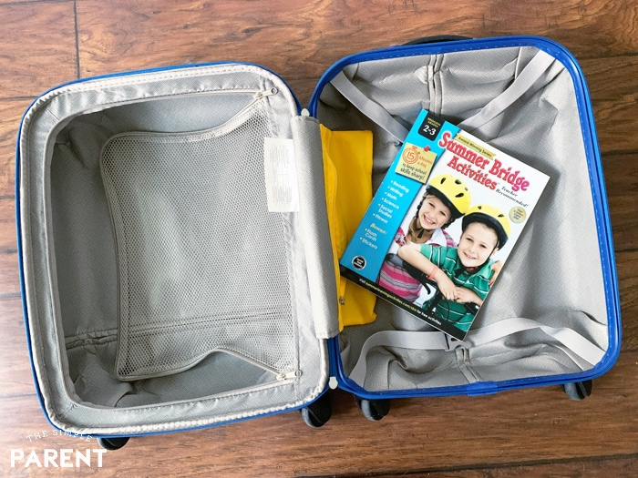 Carson Dellosa Summer Bridge Activities book in a suitcase