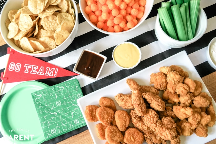 Easy kid-friendly game day food including chicken, chips, and dipping sauce