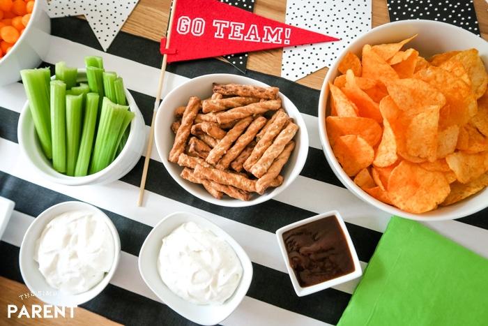 Pretzels, celery sticks, potato chips and dips