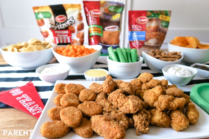Game day food spread with Tyson chicken and finger foods