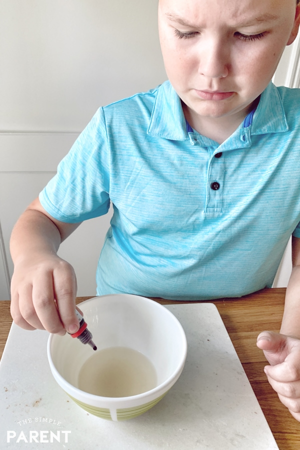 Boy making jelly blood using the Scientific Explorer® Disgusting Biology Kit