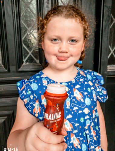 Girl drinking Brainiac Kids Yogurt Drink