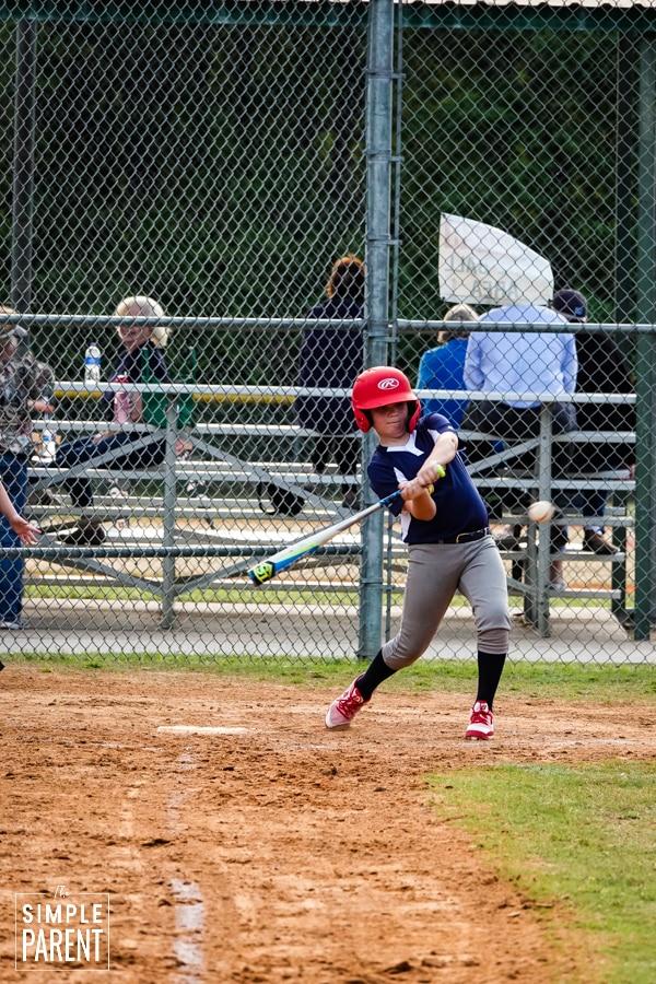 Young baseball player swinging his bat