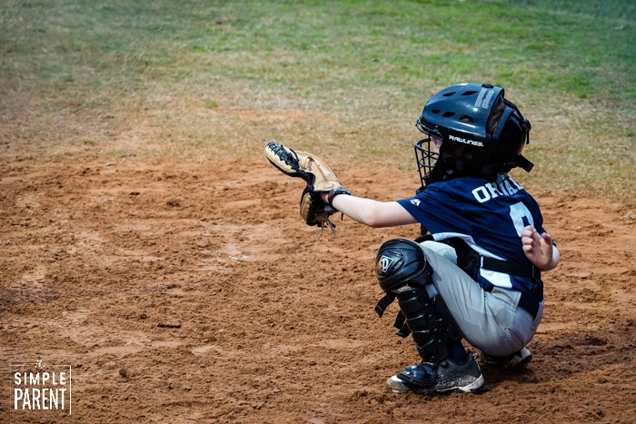 Young baseball player playing catcher