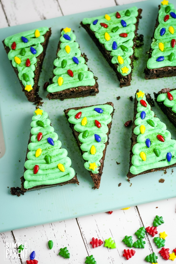 Decorating Christmas Tree shaped brownies with sprinkles