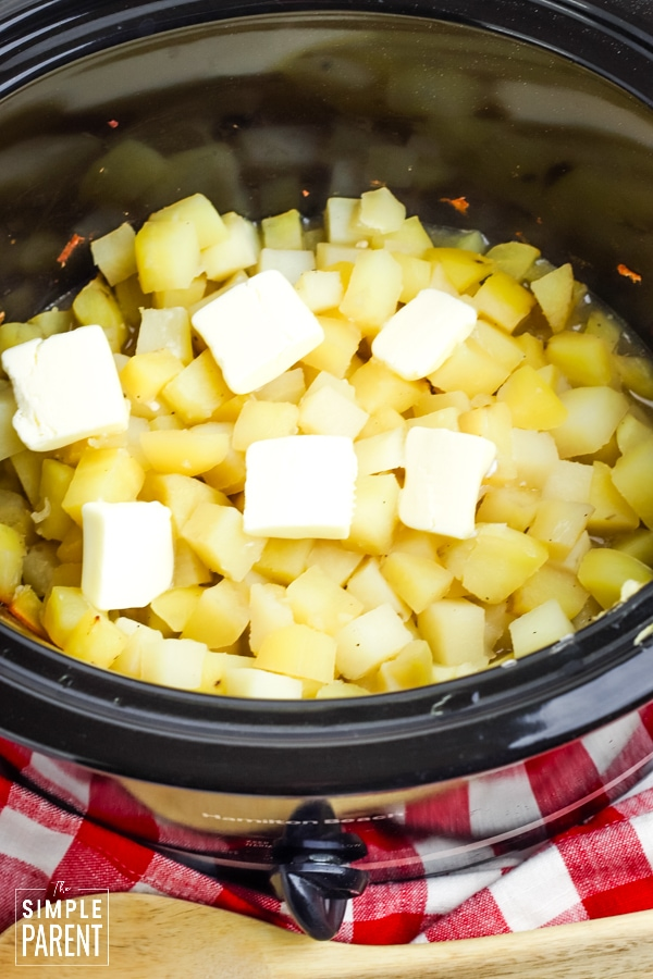 Chopped potatoes with butter in Crockpot