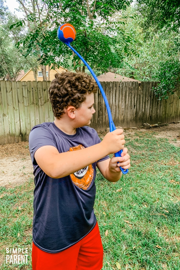 Boy getting ready to throw ball with Chuckit! Launcher dog toy