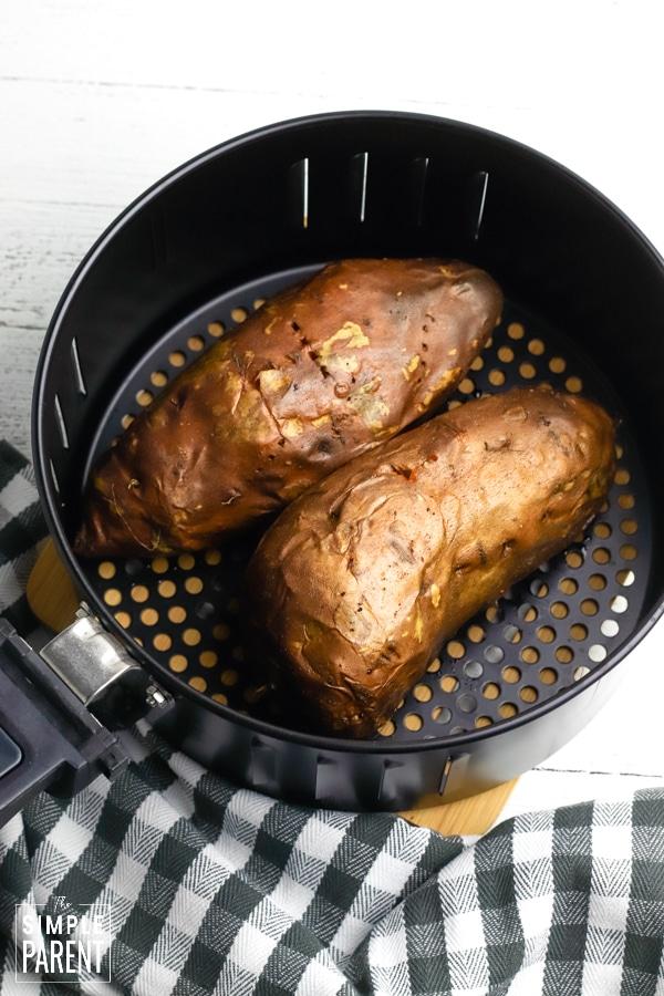 Baked sweet potatoes in air fryer basket