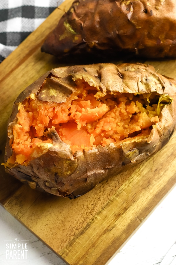 Baked yam cut open and mashed in skin
