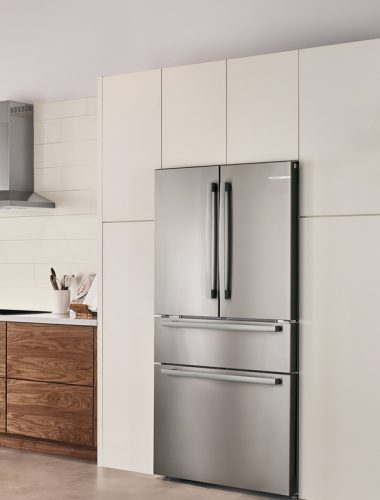 Silver Bosch Counter-Depth Refrigerator in kitchen with white cabinets