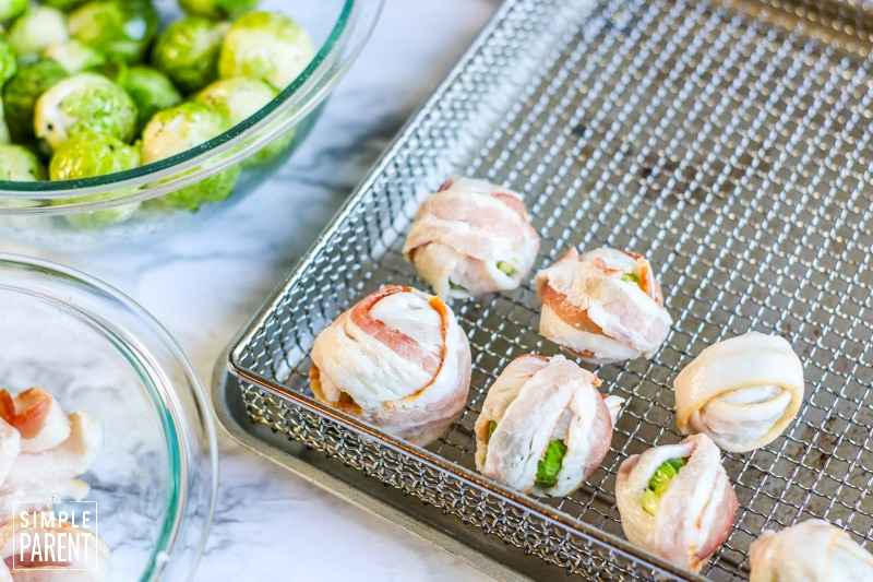 Brussels sprouts wrapped in raw bacon