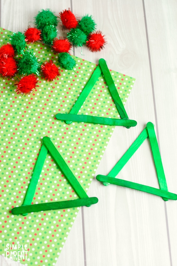 Triangles made out of green craft sticks