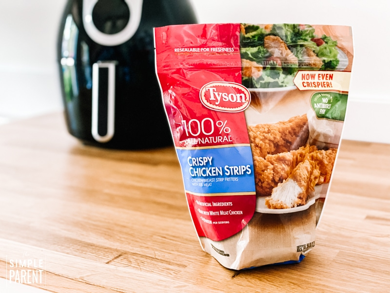 Red bag of Tyson Crispy Chicken Strips in front of an air fryer