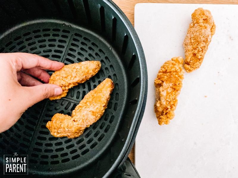 Frozen chicken tenders in air fryer basket