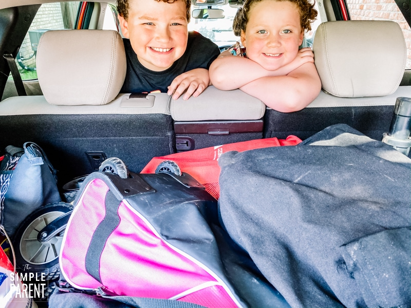 Kids looking out over the back seat of the car