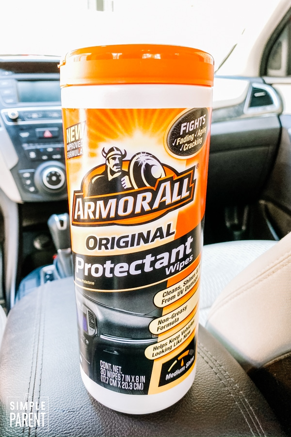 Canister of Armor All Protectant wipes on the car dash