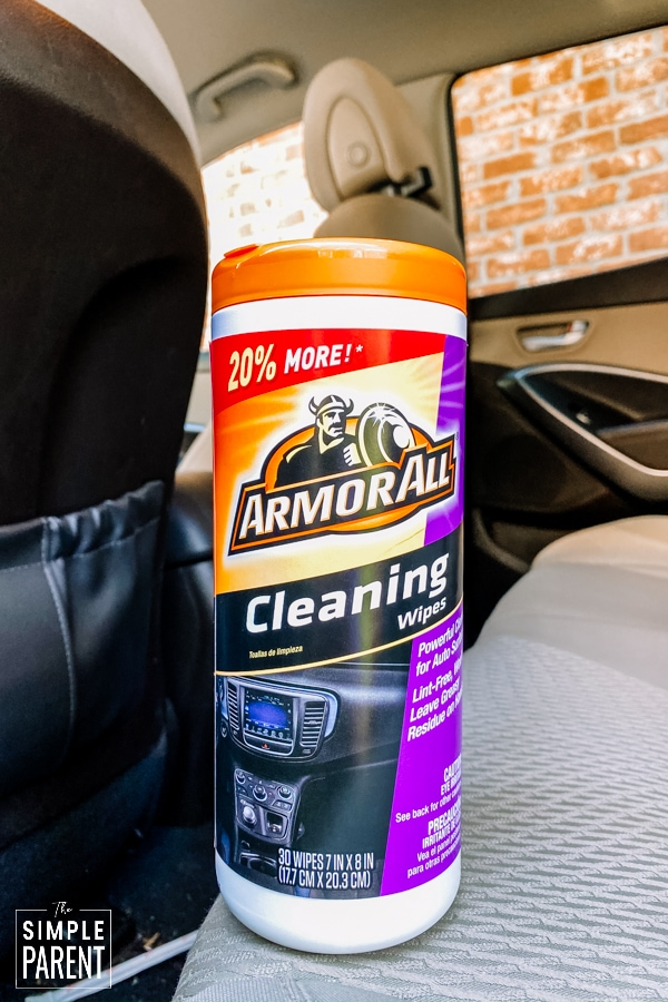 Canister of Armor All Cleaning wipes in a car