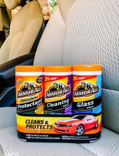 Armor All cleaning wipes 3 pack sitting on a car seat