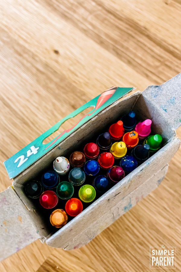Crayon box with the top open and full of crayons