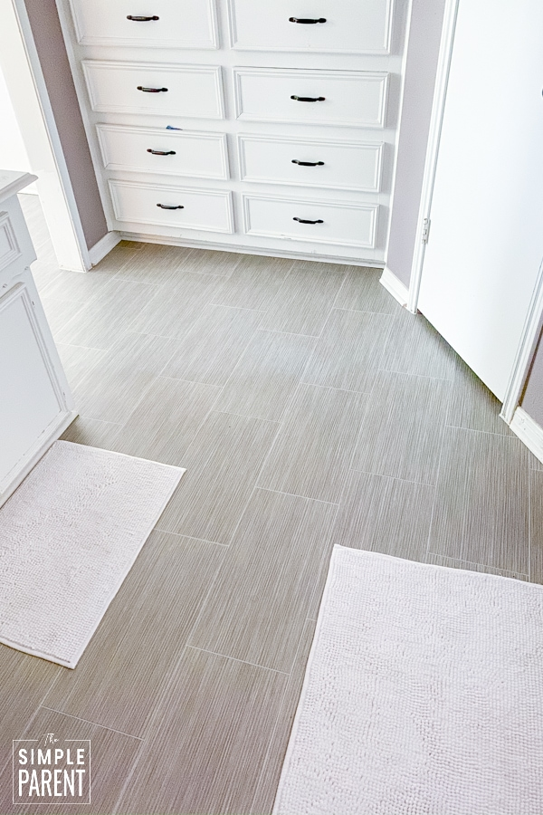 Lifeproof Sheet Vinyl flooring that looks like gray ceramic tile in a master bathroom