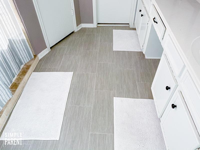 Lifeproof Sheet Vinyl flooring that looks like gray ceramic tile in a master bathroom