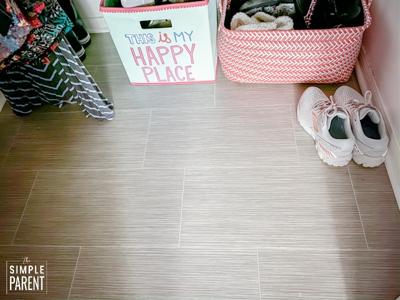 Floor of a closet with baskets of shoes