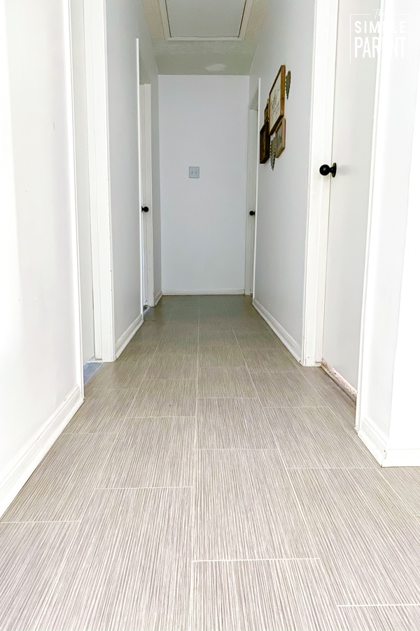 Hallway with Lifeproof Sheet Vinyl flooring in gray with white walls
