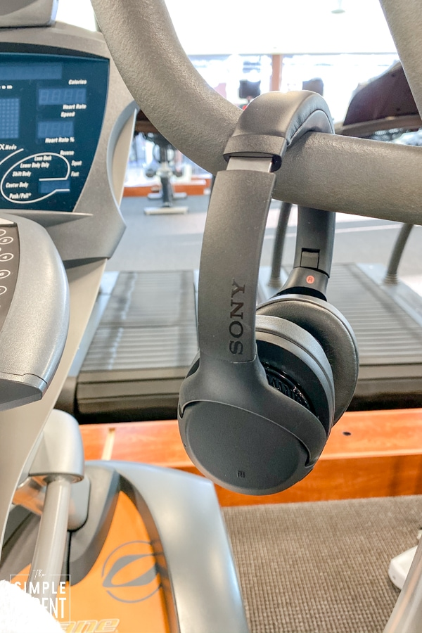 Black Sony Wireless Headphones hanging on elliptical machine
