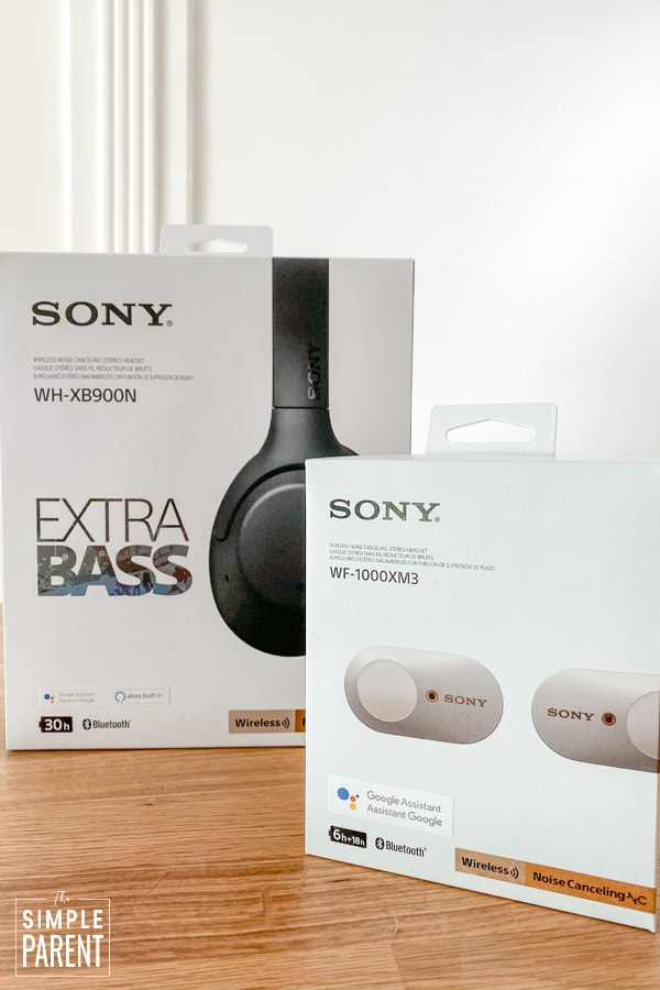 Sony Wireless In Ear and Over the Ear headphones in their boxes