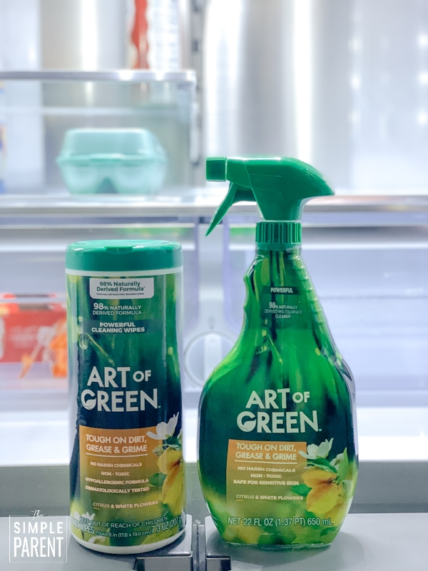 Art of Green cleaning spray and cleaning wipes sitting in a refrigerator