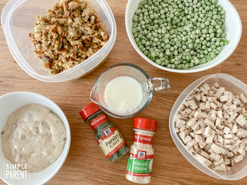 Ingredients to make leftover turkey casserole including Thanksgiving turkey, frozen peas, stuffing, and cream of mushroom soup