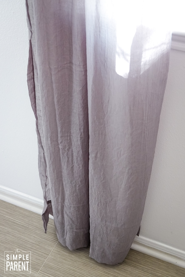 Gray sheer curtains hanging down to the floor