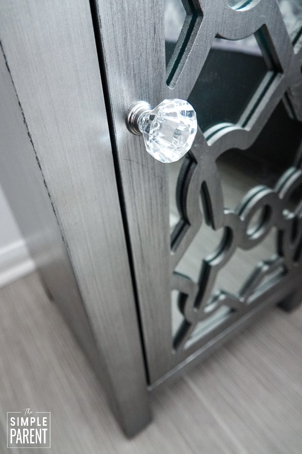 Glass knob on a nightstand with a mirrored door