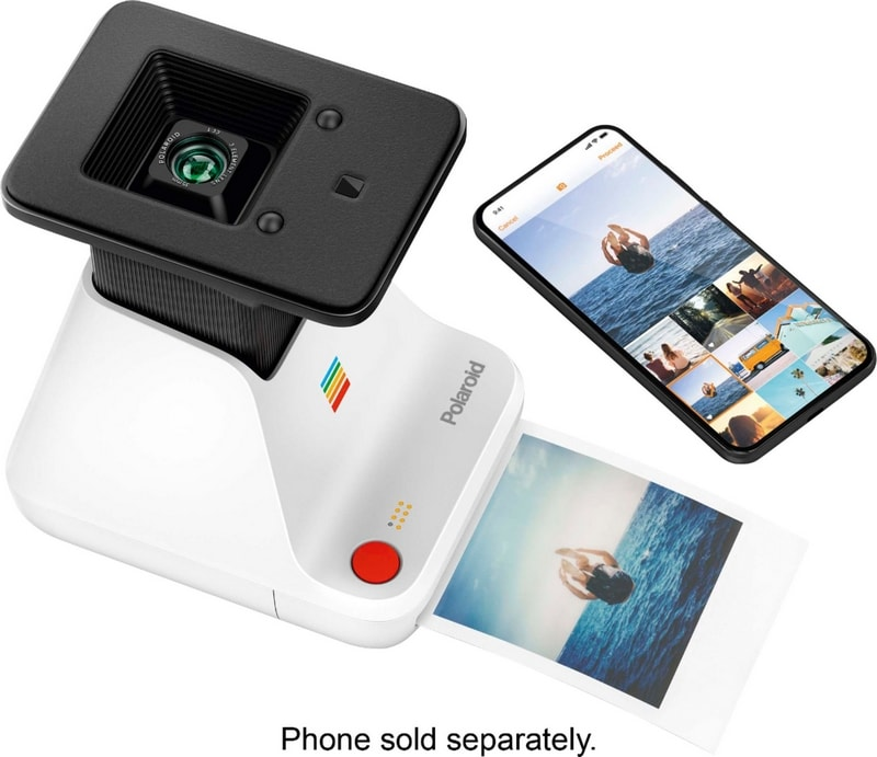 Polaroid photos sitting next to a Polaroid Lab printer and a smartphone