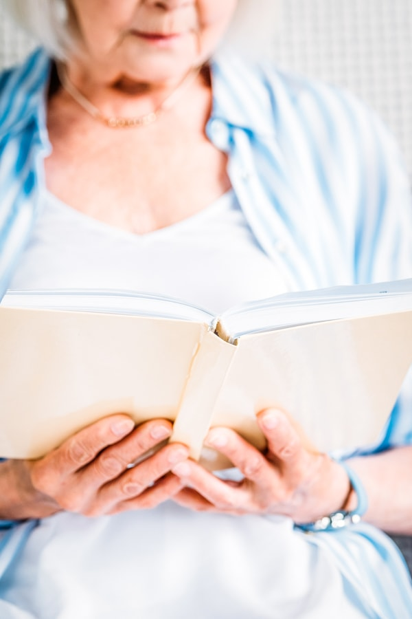 Older woman reading a journal