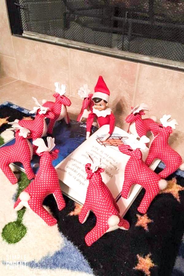 Elf reading to toy reindeer