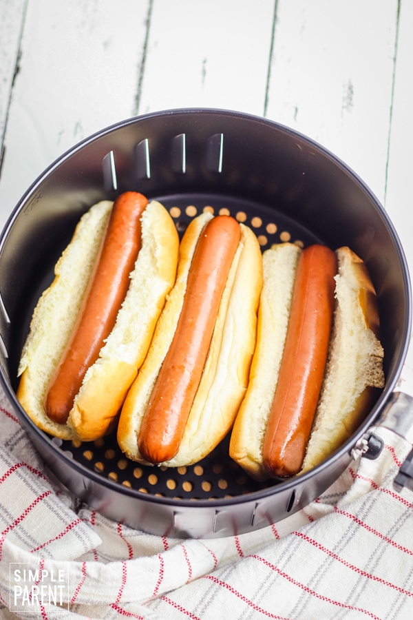 Hot dogs in buns in the air fryer basket