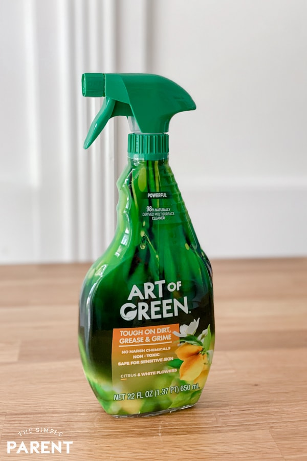 Spray bottle of Art of Green cleaner sitting on a butcher block counter