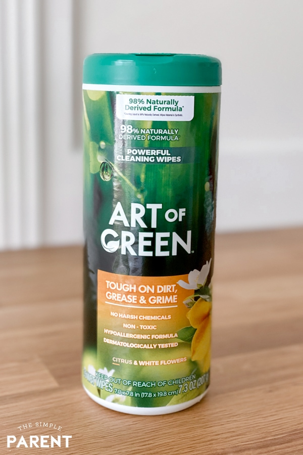 Canister of Art of Green cleaning wipes sitting on butcher block table