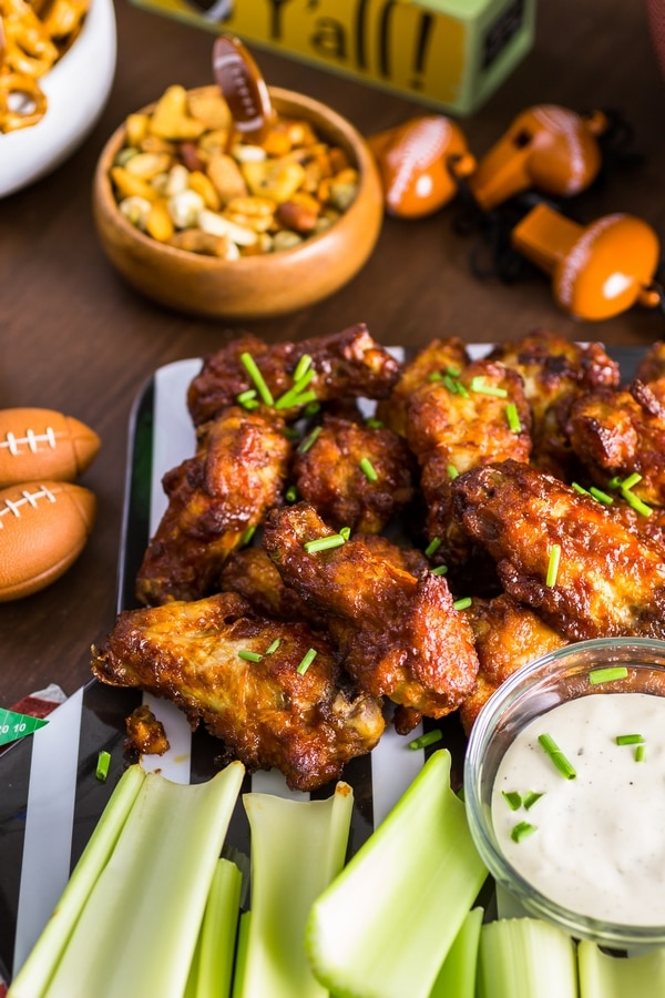 Chicken wings, celery, and dip set out for a football themed party
