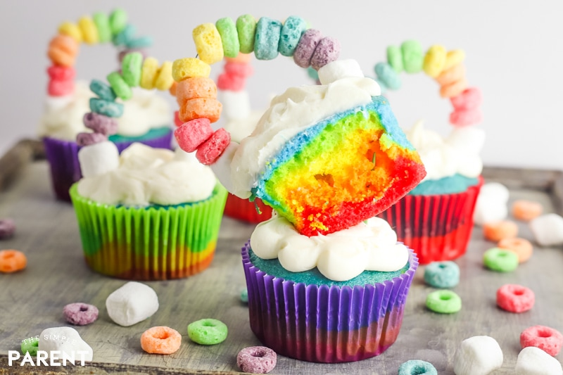 Rainbow colored cupcakes with cereal topper