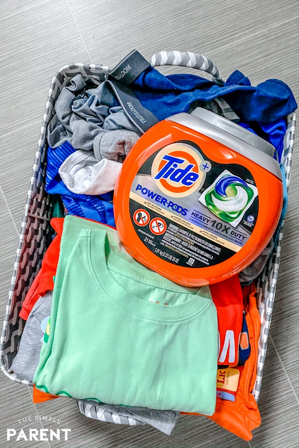 Basket of laundry with Tide Power Pods container sitting on top