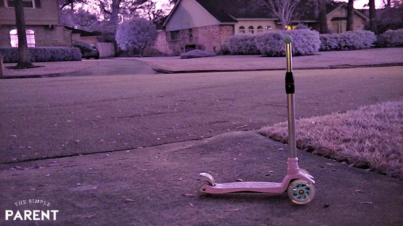 Child's scooter in a driveway at night shot with Sionyx camera
