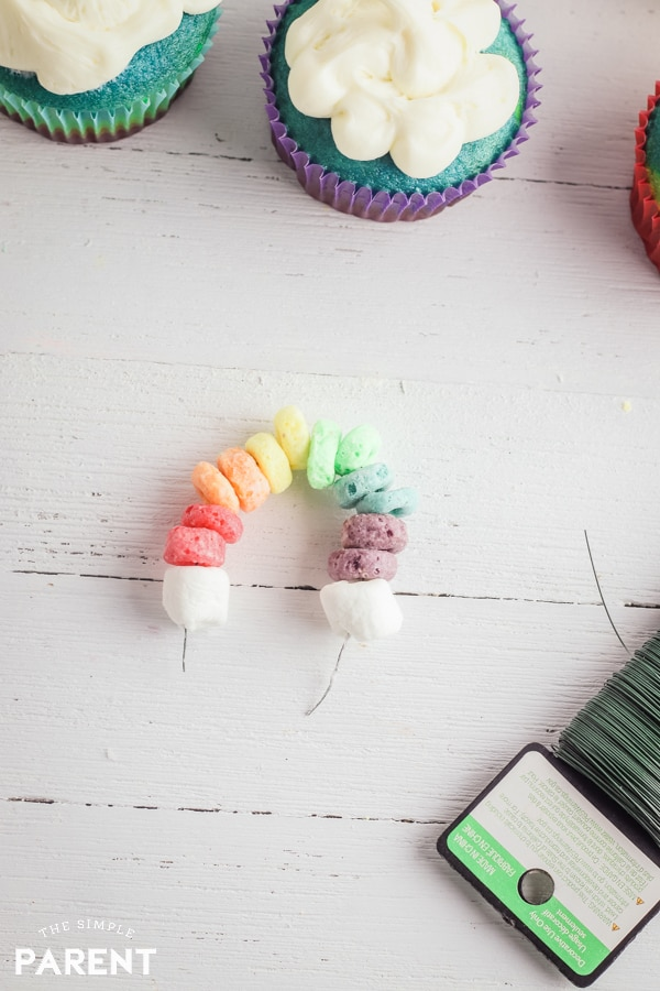 Rainbow cake topper made with cereal and mini marshmallows