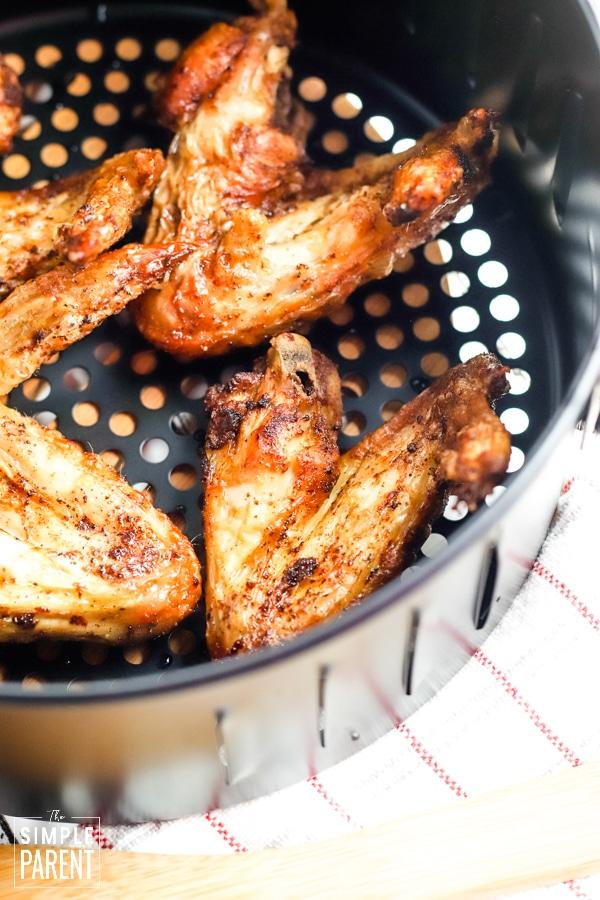 Seasoned wings in air fryer basket