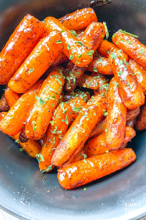 Oven Roasted Carrots in a bowl and garnished with parsley